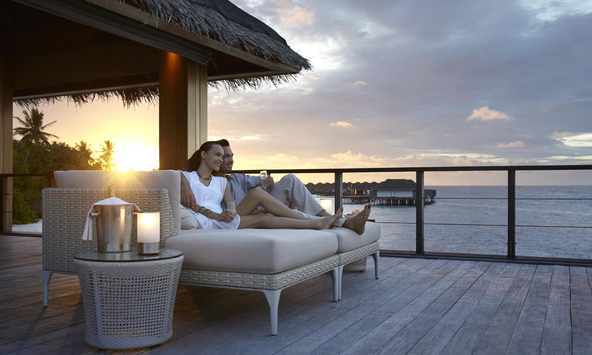 Dusit Thani Maldives - couple dining on sofa
